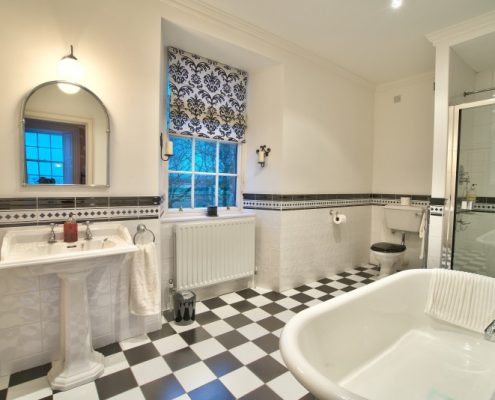 Ensuite bathroom with bath and drenching shower